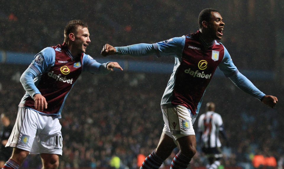 Photo - Aston Villa's Leandro Bacuna, right, celebrates scoring the second goal, during the English Premier League match against West Bromwich Albion, at Villa Park, Birmingham, England, Wednesday Jan. 29, 2014. (AP Photo/PA, Nick Potts) UNITED KINGDOM OUT
