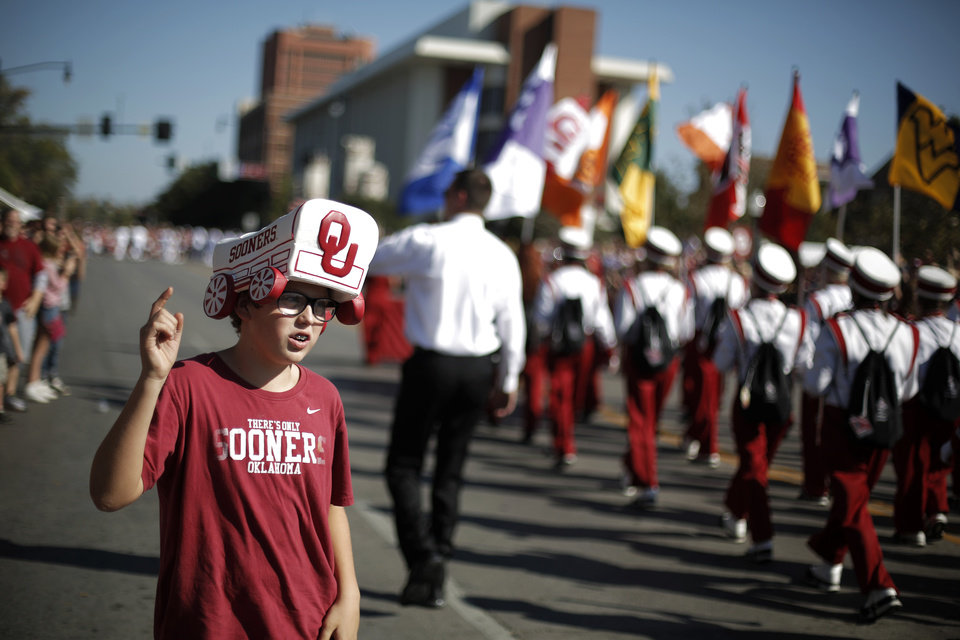 Ethan Geiger, 11 of Norman, cheers for the Pride of Oklahoma Marching Band during the University of Oklahoma Homecoming Parade in Norman, Okla., Saturday, Oct. 20, 2012. Photo by Garett Fisbeck, The Oklahoman