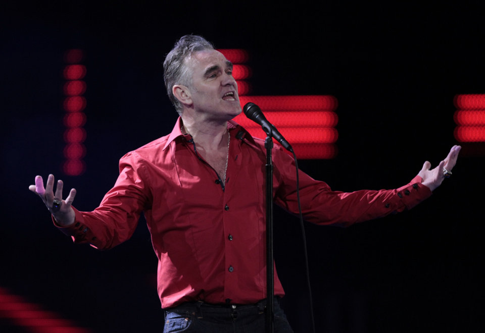 FILE - In this Friday, Feb. 24, 2012 file photo, England's singer Morrissey performs at the 53rd annual Vina del Mar International Song Festival in Vina del Mar, Chile. Animal rights activist and singer Morrissey said he�s canceled an appearance Tuesday, Feb. 26, 2013, on Jimmy Kimmel�s talk show because cast members of A&E�s �Duck Dynasty� also were scheduled to appear. (AP Photo/Jorge Saenz, File)