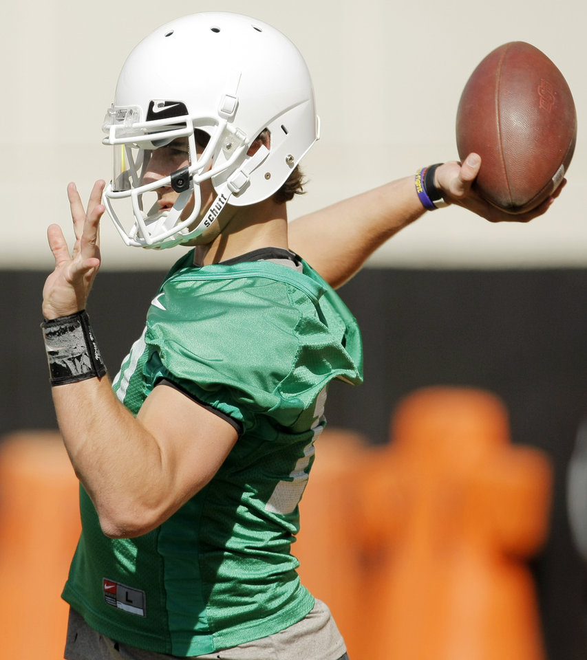 Clint Chelf (10) passes during OSU spring football practice at Boone Pickens Stadium on the campus of Oklahoma State University in Stillwater, Okla., Monday, March 12, 2012. Photo by Nate Billings, The Oklahoman