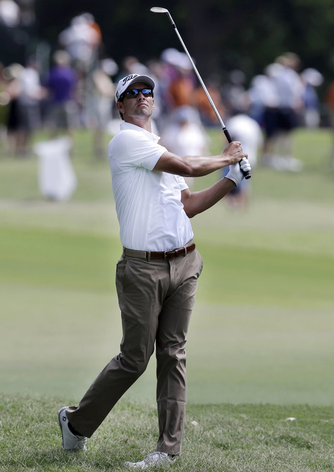 Photo - Adam Scott watches an approach shot on the ninth hole during the third round of the PGA Colonial golf tournament in Fort Worth, Texas, Saturday, May 24, 2014. (AP Photo/LM Otero)
