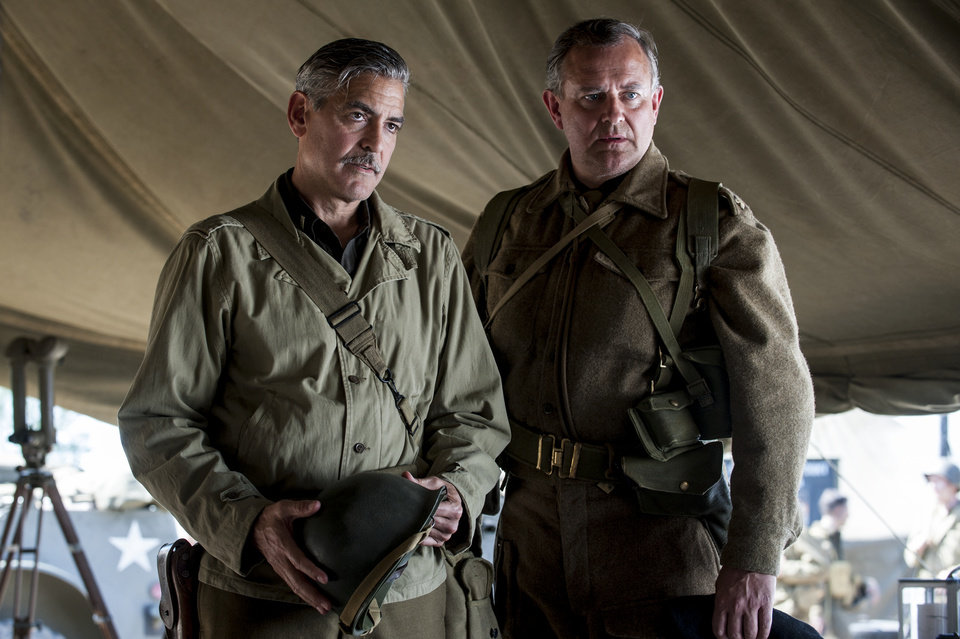 Photo - This image released by Columbia Pictures shows George Clooney, left, and Hugh Bonneville in