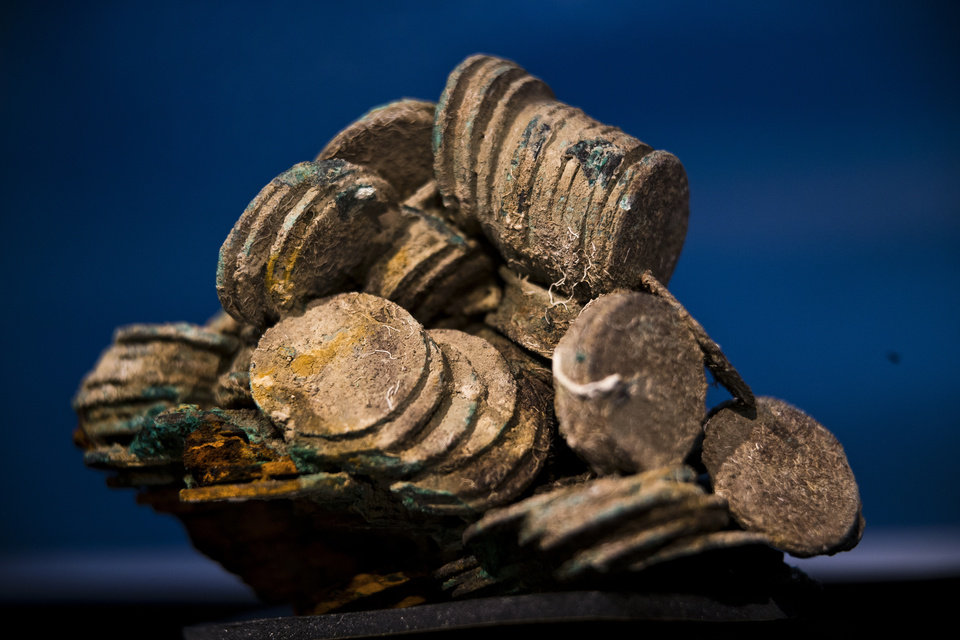 A block of encrusted silver coins from the shipwreck of a 1804 galleon, on its first display to the media at a Ministry building, in Madrid, Friday, Nov. 30, 2012. Spanish cultural officials have allowed the first peep at 16 tons (14.5 metric tons) of the shipwreck, \'Nuestra Senora de las Mercedes\' a treasure worth an estimated $500 million that a U.S. salvage company gave up after a five-year international ownership dispute. (AP Photo/Daniel Ochoa de Olza)