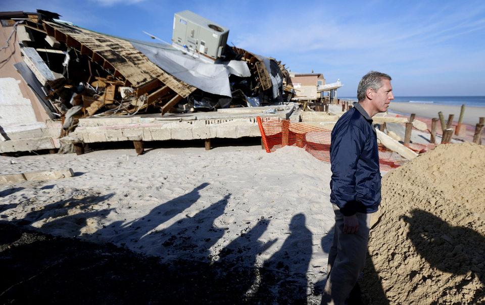 New Jersey State Assemblyman Erik Petersen looks toward the beach as damage caused by Superstorm Sandy is seen on the Surf Club, Thursday, Nov. 29, 2012, in Ortley Beach, N.J. The New Jersey General Assembly took a tour of areas hit a month after the storm. (AP Photo/Julio Cortez)