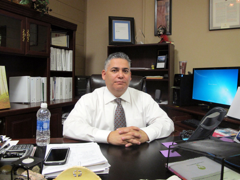 Photo - La Villa Independent School District Superintendent Narciso Garcia poses for a photo in his office in La Villa, Texas, Monday, Jan. 13, 2014. A water payment dispute between the city and school district has shut down the schools. (AP Photo/Chris Sherman)