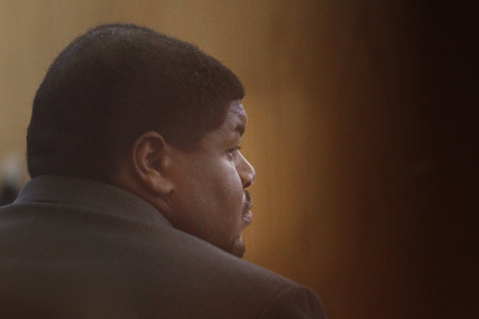 Photo - Josh Brent, a former Dallas Cowboys player, listens a witness testifies during his trial at the Frank Crowley Courts building in Dallas, Monday, Jan. 13, 2014. Brent is charged with intoxication manslaughter in the December 2012 death of his friend and former college teammate, Jerry Brown, in a December 2012 crash. (AP Photo/The Dallas Morning News, Kye R. Lee)