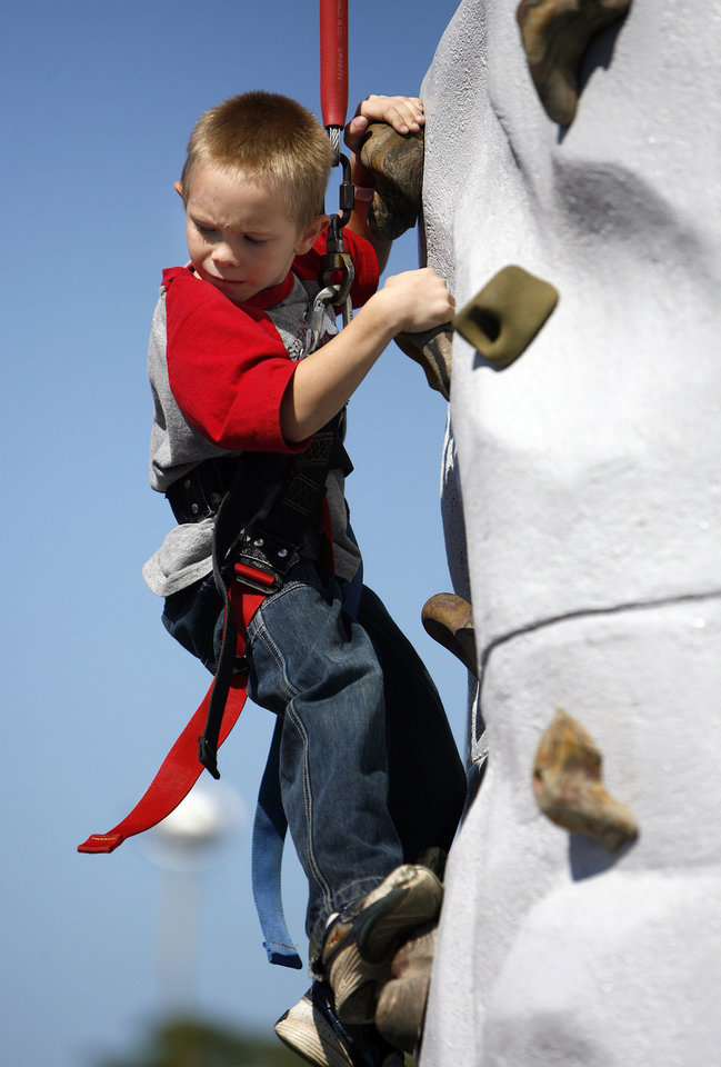Dakota Liske, 7, of Oklahoma City climb a rock wall at the Oklahoma State Fair, Sunday, September 14, 2008, in Oklahoma City. BY SARAH PHIPPS, THE OKLAHOMAN