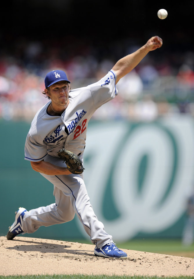 Photo - FILE - In this July 21, 2013, file photo, Los Angeles Dodgers starting pitcher Clayton Kershaw delivers a pitch against the Washington Nationals during the first inning of a baseball game in Washington. Kershaw won the National League Cy Young Award, Wednesday, Nov. 13, 2013. (AP Photo/Nick Wass, File)