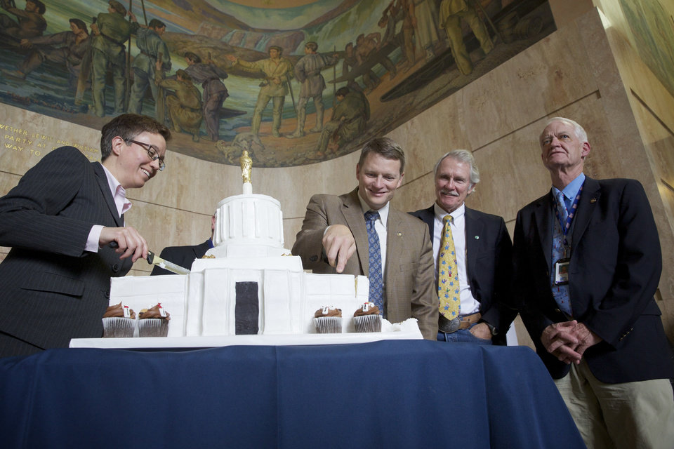 Photo - House Speaker Tina Kotek, left, House Minority Leader Mike McLane, second from the left, Gov. John Kitzhaber, second from right, and Senate President Peter Courtney  take a break from their duties to the special session of the Oregon Legislature to cut the cake celebrating the 75th birthday of the Oregon State Capitol Tuesday, Oct. 1, 2013 in Salem, Ore. (AP Photo/The Oregonian, Michael Lloyd)  MAGS OUT; TV OUT; LOCAL TV OUT; LOCAL INTERNET OUT; THE MERCURY OUT; WILLAMETTE WEEK OUT; PAMPLIN MEDIA GROUP OUT