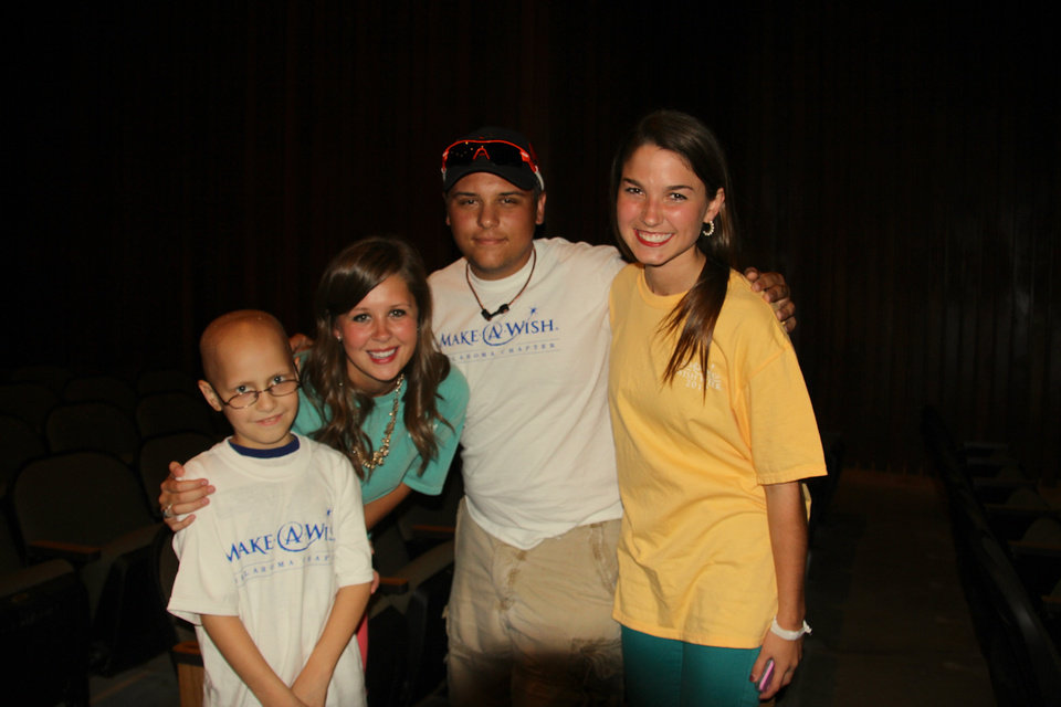 Wish kids Jacob and Hunter are shown with Wish Week chai Allie Wilson, of Edmond, and co-chair Libby Mitchell, of Heritage Hall. Chi Omega sorority at OSU raised $60,134 for Oklahoma Wish Kids. (Photo provided)