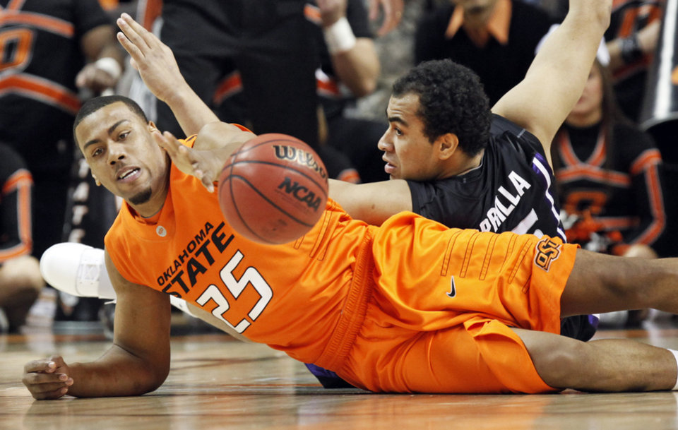 Photo - OSU's Darrell Williams (25) and Freddy Asprilla (15) of KSU chase the ball during the men's college basketball game between Oklahoma State University (OSU) and Kansas State University (KSU) at Gallagher-Iba Arena in Stillwater, Okla., Saturday, January 8, 2011. Photo by Nate Billings, The Oklahoman