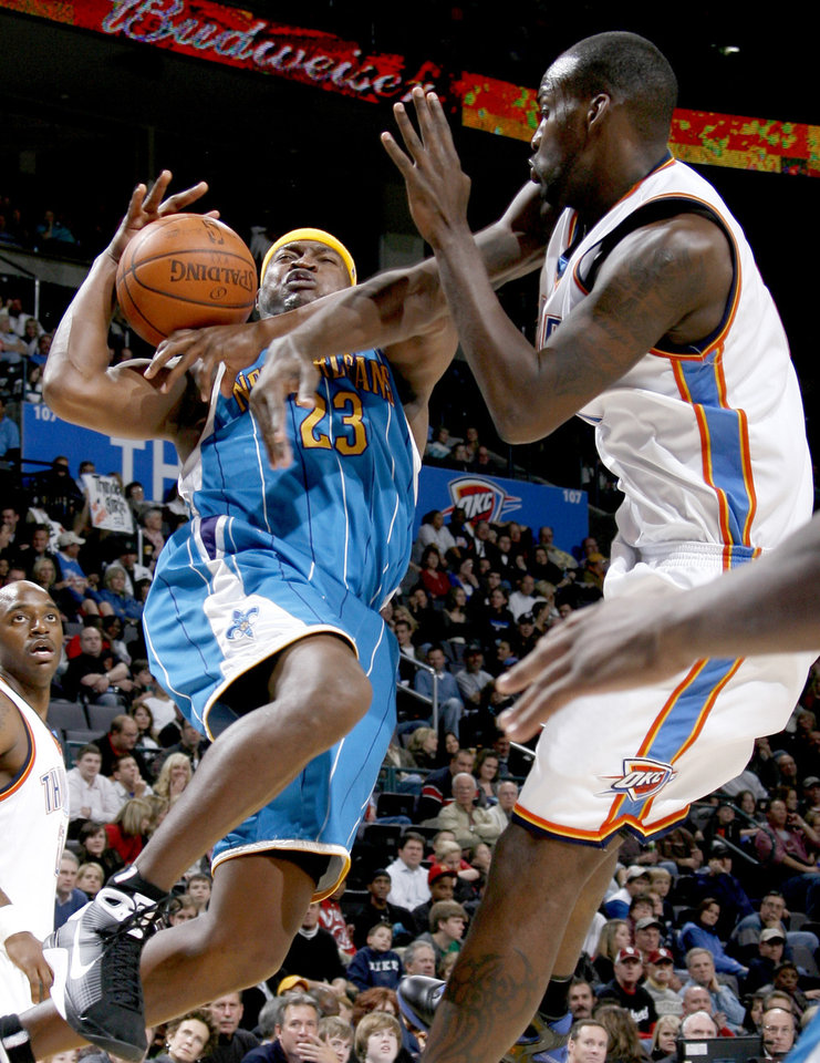 Oklahoma City's Johan Petro fouls Devin Brown of New Orleans during the NBA basketball game between the Oklahoma City Thunder and the New Orleans Hornets at the Ford Center in Oklahoma City on Friday, Nov. 21, 2008.   BY BRYAN TERRY, THE OKLAHOMAN \