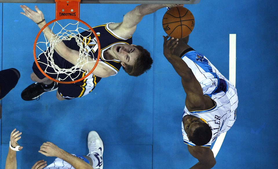Utah Jazz guard Gordon Hayward (20) battles under the basket with New Orleans Hornets forward Darius Miller in the first half of an NBA basketball game in New Orleans, Wednesday, Nov. 28, 2012. (AP Photo/Gerald Herbert)