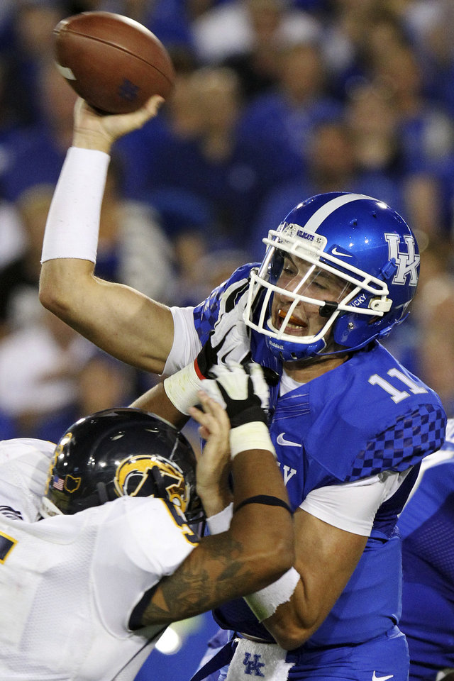 Photo -   Kentucky's Maxwell Smith (11) is pressured by Kent State's Roosevelt Nix (5) during the second quarter of an NCAA college football game in Lexington, Ky., Saturday, Sept. 8, 2012. (AP Photo/James Crisp)