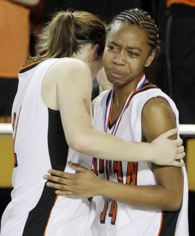 Photo - Chelsea Key (11), left, and  Laran Vanderpool (14) of Norman hug after the Class 6A girls high school basketball state tournament final between Midwest City and Norman at the ORU Mabee Center in Tulsa, Okla., Saturday, March 13, 2010. Midwest City won, 46-32. Photo by Nate Billings, The Oklahoman