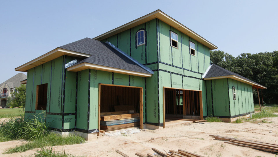 Photo - Builder Phil Boevers has this home under construction at 4159 Oaks Terrace in The Oaks addition in Piedmont.  PAUL B. SOUTHERLAND - The Oklahoman