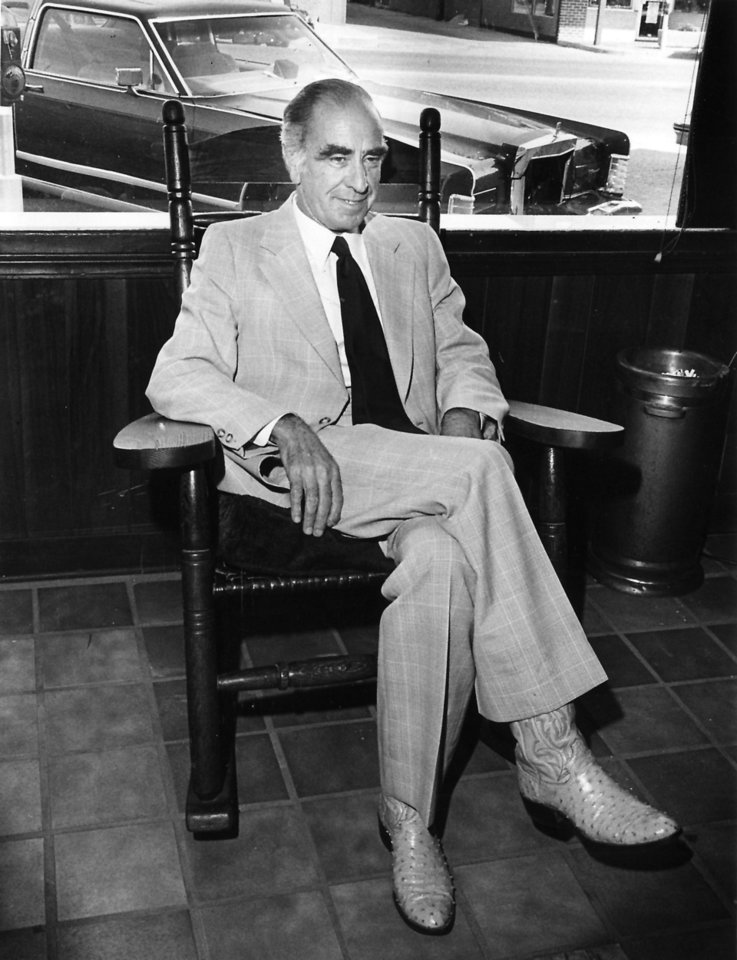 Cattlemen\'s Steakhouse owner Gene Wade sits in a rocking chair at the restaurant in 1981. OKLAHOMAN ARCHIVE PHOTO GEORGE R. WILSON - STAFF PHOTO