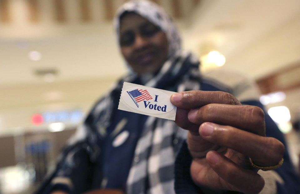 "Addey Munye, 67, shows off her ""I Voted"" sticker after she cast her ballot in her first election at a polling station in the West Acres Mall in Fargo, N.D, Tuesday, Nov. 6, 2012. Munye is originally from Somalia. (AP Photo/LM Otero)"