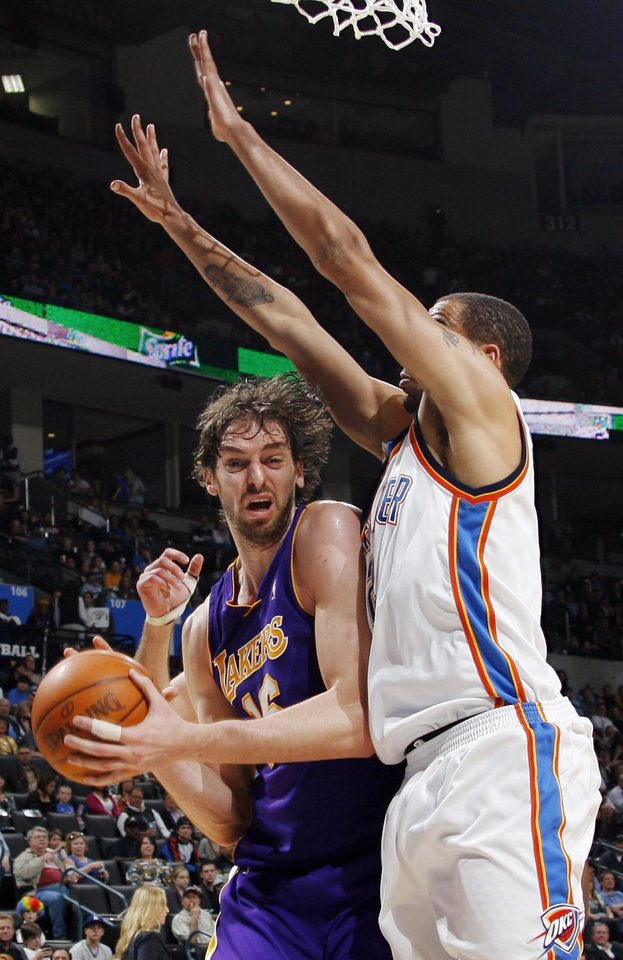 Photo - Pau Gasol (16) of Los Angeles tries to work around the defense of Oklahoma City's Thabo Sefolosha (2) during the NBA basketball game between the Los Angeles Lakers and the Oklahoma City Thunder at the Ford Center in Oklahoma City, Friday, March 26, 2010. Oklahoma City won, 91-75. Photo by Nate Billings, The Oklahoman