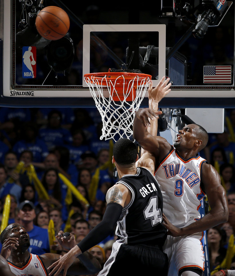 Photo - Oklahoma City's Serge Ibaka (9) blocks San Antonio's Danny Green (4) during Game 3 of the Western Conference Finals in the NBA playoffs between the Oklahoma City Thunder and the San Antonio Spurs at Chesapeake Energy Arena in Oklahoma City, Sunday, May 25, 2014. Photo by Bryan Terry, The Oklahoman