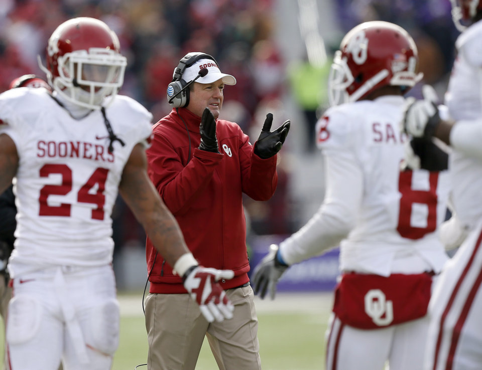 Oklahoma coach Bob Stoops reacts after a touchdown during an NCAA college football game between the Oklahoma Sooners and the Kansas State University Wildcats at Bill Snyder Family Stadium in Manhattan, Kan., Saturday, Nov. 23, 2013. Oklahoma won 41-31. Photo by Bryan Terry, The Oklahoman