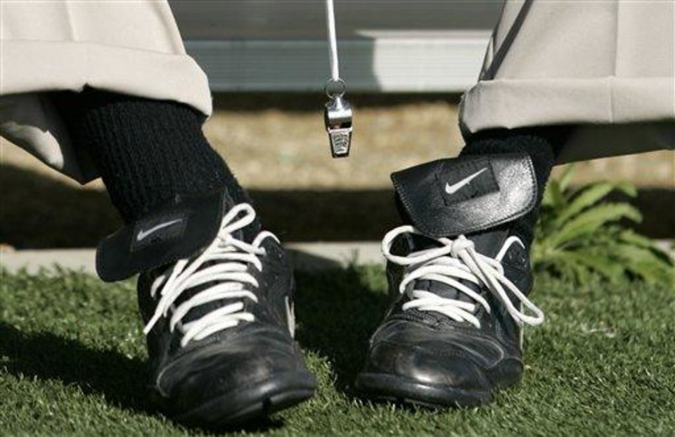 Photo - The shoes and whistle belonging to Penn State coach Joe Paterno are seen as he sits before practice for the Rose Bowl Game in Carson, Calif., Saturday, Dec. 27, 2008. Penn State plays Southern California in the Rose Bowl NCAA college football game on New Year's Day in Pasadena, Calif. (AP Photo/Danny Moloshok)