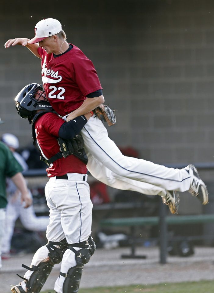 Photo - Tuttle's Austin Garrett celebrates with Zac Wall following the class 4A baseball game between Catoosa and Tuttle at Edmond Santa Fe High School in Edmond, Okla., Friday, May 16, 2014. Photo by Sarah Phipps, The Oklahoman
