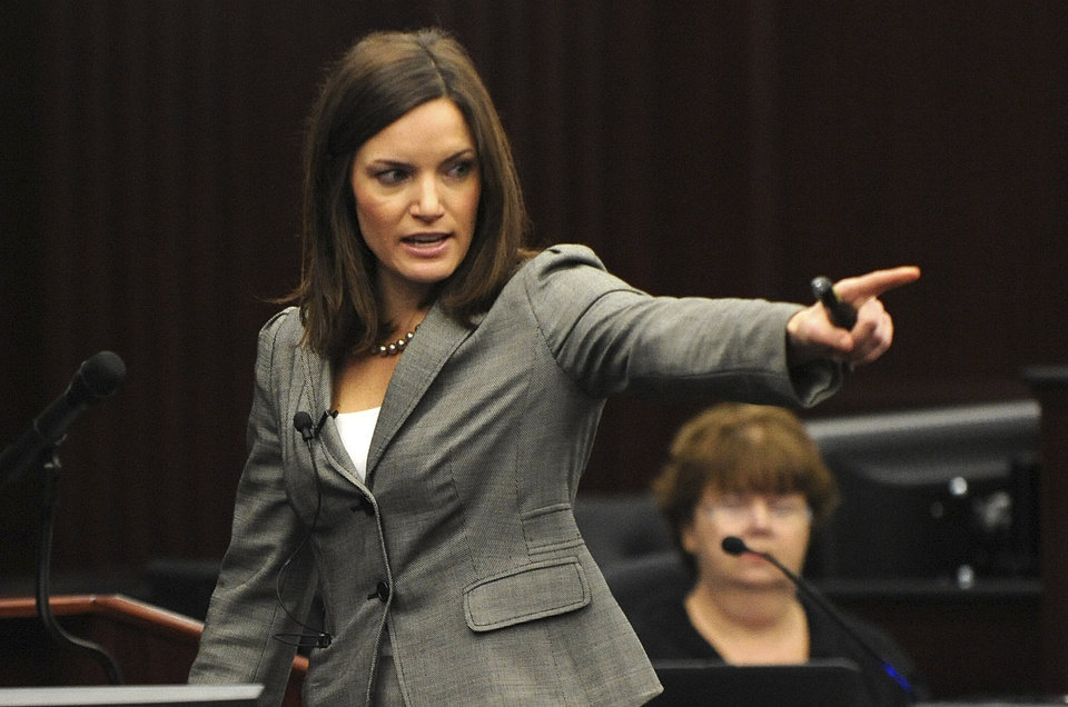 Photo - Assistant State Attorney Erin Wolfson points at the defendant Michael Dunn during the State's closing arguments in Dunn's trial, Wednesday, Feb. 12, 2014 in Jacksonville, Fla. Dunn is charged with fatally shooting 17-year-old Jordan Davis after an argument over loud music outside a Jacksonville convenient store in 2012.(AP Photo/The Florida Times-Union, Bob Mack, Pool)