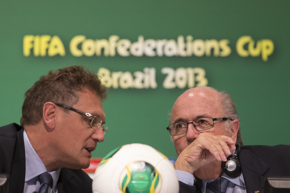 Photo - FIFA's General Secretary Jerome Valcke, left, speaks with FIFA President Joseph S. Blatter during a press conference in Rio de Janeiro, Brazil, Friday, June 28, 2013. The final of the soccer Confederations Cup will be played by Spain and Brazil on Sunday, June 30, 2013 in the Maracana stadium in Rio.  (AP Photo/Felipe Dana)