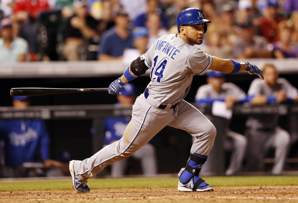 Photo - Kansas City Royals' Omar Infante hits a two-run double against the Colorado Rockies during the seventh inning of a baseball game Tuesday, Aug. 19, 2014, in Denver. (AP Photo/Jack Dempsey)
