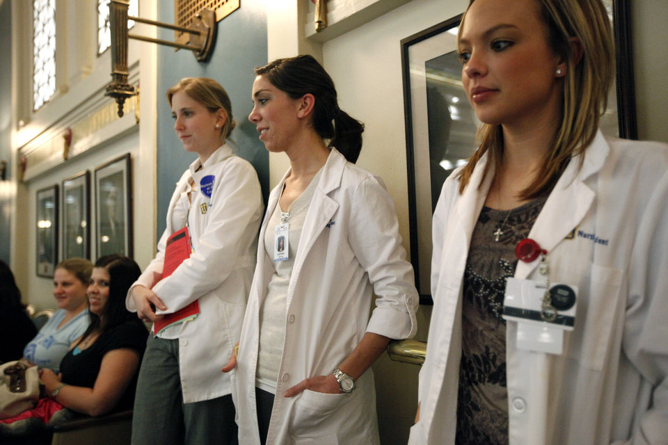 From left to right, University of Tulsa nursing students Lauren Petrocch, Suzanne Hishmeh and Korie Brown watch the Senate during Nurses Day at the Capitol, Tuesday, Feb. 28, 2012. Photo by Sarah Phipps, The Oklahoman