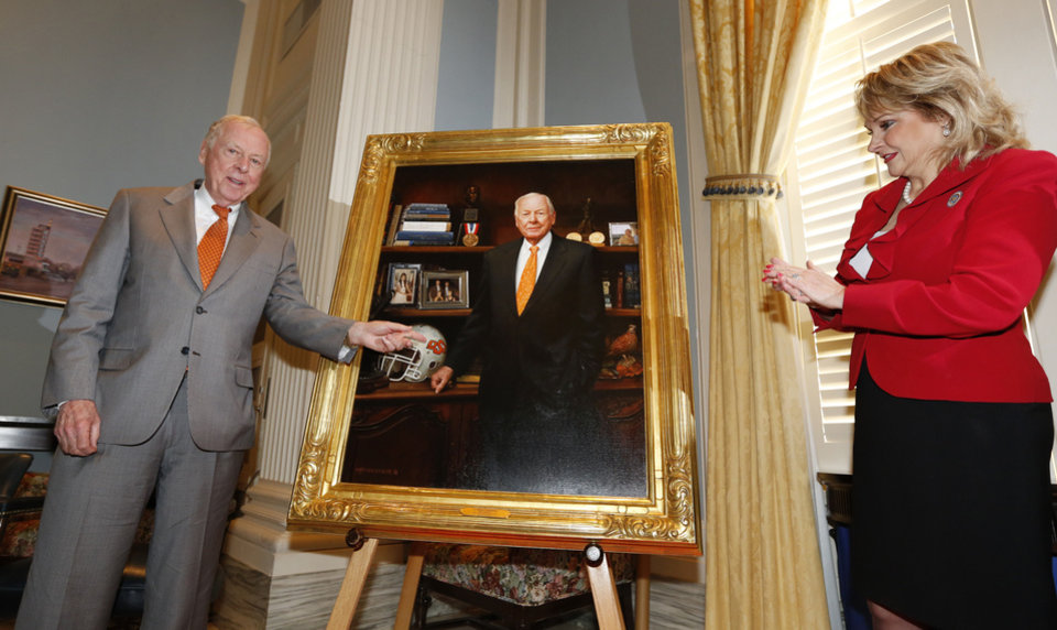 Photo - T. Boone Pickens and Oklahoma Governor Mary Fallin admire Picken's portrait after it was unveiled during a ceremony at the State Capitol in Oklahoma City, Thursday February 14, 2013. The portrait was painted by Oklahoma artist Mike Wimmer. Photo By Steve Gooch, The Oklahoman