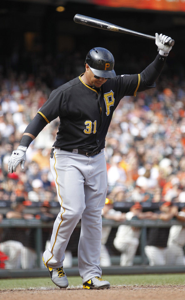 Photo - Pittsburgh Pirates' Jose Tabata reacts after striking out against the San Francisco Giants in the ninth inning of a baseball game in San Francisco, Sunday, Aug. 25, 2013. The Giants won 4-0. (AP Photo/Tony Avelar)