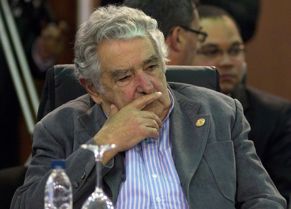 Photo -   FILE - In this Dec. 3, 2011 file photo, Uruguay's President Jose Mujica attends a working session of the Community of Latin American and Caribbean States, CELAC, summit in Caracas, Venezuela. Uruguay's president has canceled his trip Thursday, Nov. 15, 2012, to the Ibero-American Summit in Spain, saying doctors have ordered bed rest after a painful blood clot was found in his lower right leg. The 77-year-old Jose Mujica says the clot was found with a sonogram and that he's following doctors' orders to relax at home for two or three days while taking anti-coagulant medicine. (AP Photo/Ariana Cubillos, File)