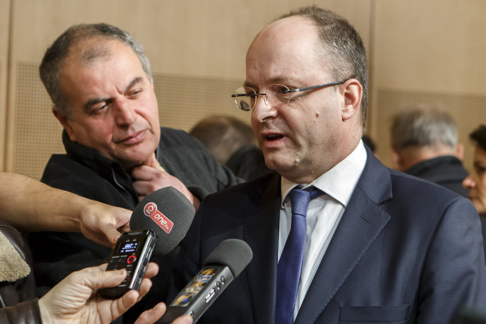 Photo - Olivier Jornot, Prosecutor General of the Canton of Geneva, right, answers questions to reporters about a hijacked Ethiopian Airlines Plane, during a press conference, in Geneva, Switzerland, Monday, February 17, 2014. The co-pilot, an Ethiopian man born in 1983, took control of the plane when the pilot ventured outside the cockpit. The man wanted asylum in Switzerland. Jornot said Swiss federal authorities were investigating the hijacking and would press charges that could carry a prison sentence of up to 20 years. (AP Photo/Keystone, Salvatore Di Nolfi)