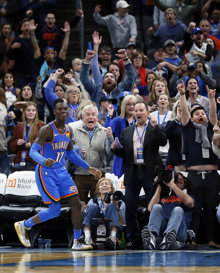 Photo - Thunder fans react after Oklahoma City's Dennis Schroder (17) hit the shot to send the game to overtime during an NBA basketball game between the Minnesota Timberwolves and the Oklahoma City Thunder at Chesapeake Energy Arena in Oklahoma City, Friday, Dec. 6, 2019. Oklahoma City won 139-127 in overtime. [Nate Billings/The Oklahoman]