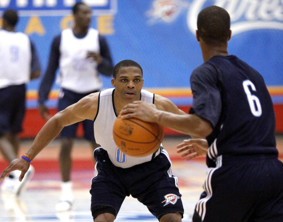 Russell Westbrook guards Eric Maynor during Friday's scrimmage at Yukon High School. PHOTO BY HUGH SCOTT, THE OKLAHOMAN
