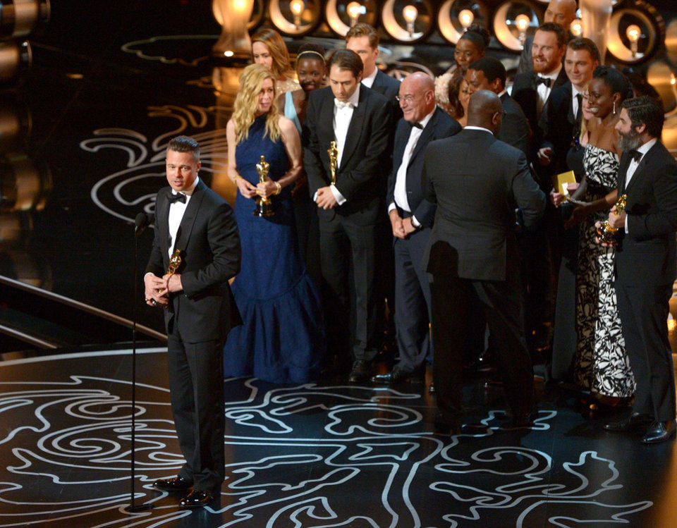 Photo - Brad Pitt, left, speaks as he and the cast and crew of