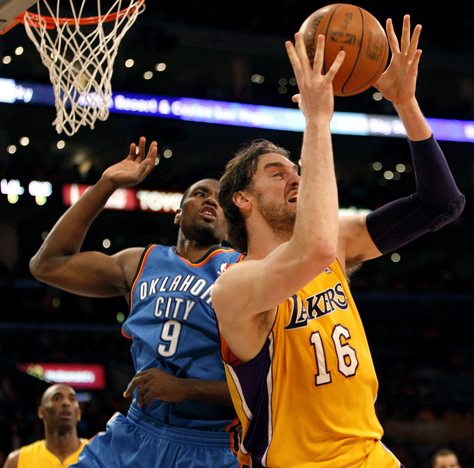 Los Angeles' Pau Gasol (16) rebounds against Oklahoma City's Serge Ibaka (9) during Game 3 in the second round of the NBA basketball playoffs between the L.A. Lakers and the Oklahoma City Thunder at the Staples Center in Los Angeles, Friday, May 18, 2012. Photo by Nate Billings, The Oklahoman