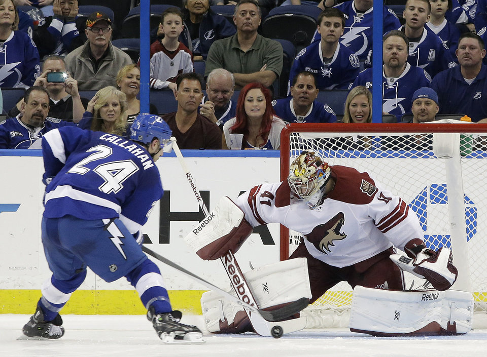 Photo - Phoenix Coyotes goalie Mike Smith (41) stops Tampa Bay Lightning right wing Ryan Callahan (24) during a shoot out in an NHL hockey game Monday, March 10, 2014, in Tampa, Fla. The Coyotes won the game 4-3. (AP Photo/Chris O'Meara)