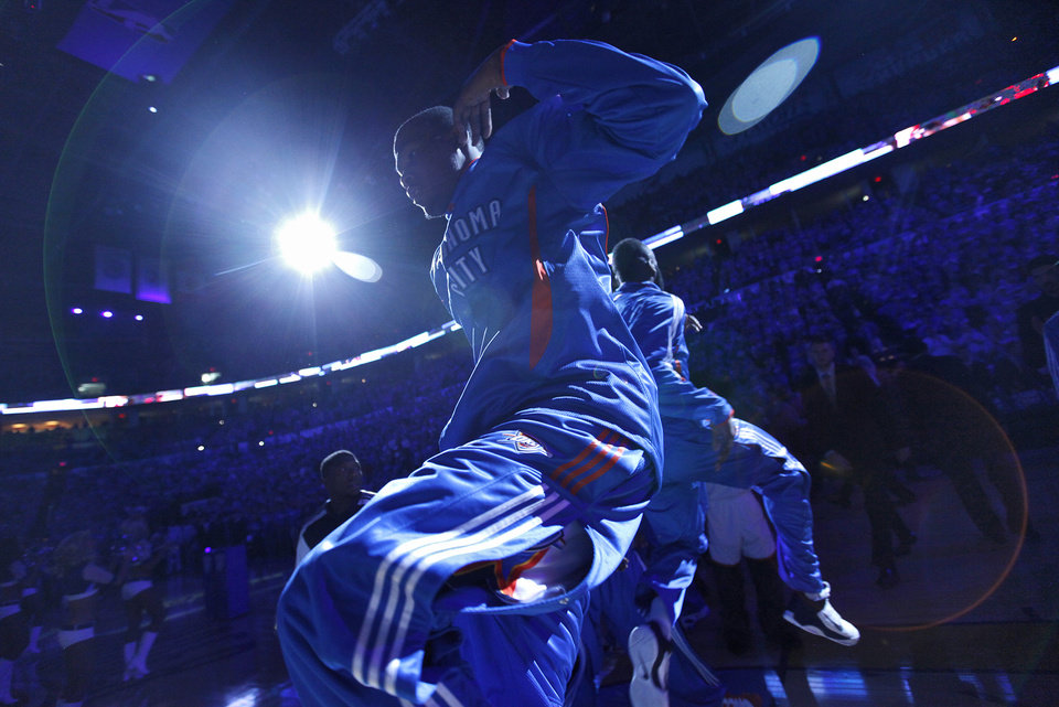 Photo - Oklahoma City's Kevin Durant makes his way onto the court in team introductions during game one of the Western Conference semifinals between the Memphis Grizzlies and the Oklahoma City Thunder in the NBA basketball playoffs at Oklahoma City Arena in Oklahoma City, Sunday, May 1, 2011. Photo by Chris Landsberger, The Oklahoman