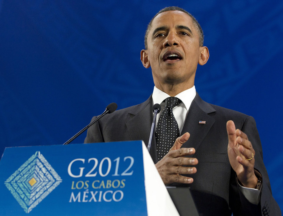Photo -   President Barack Obama speaks during a news conference at the G20 Summit, Tuesday, June 19, 2012, in Los Cabos, Mexico. (AP Photo/Carolyn Kaster)
