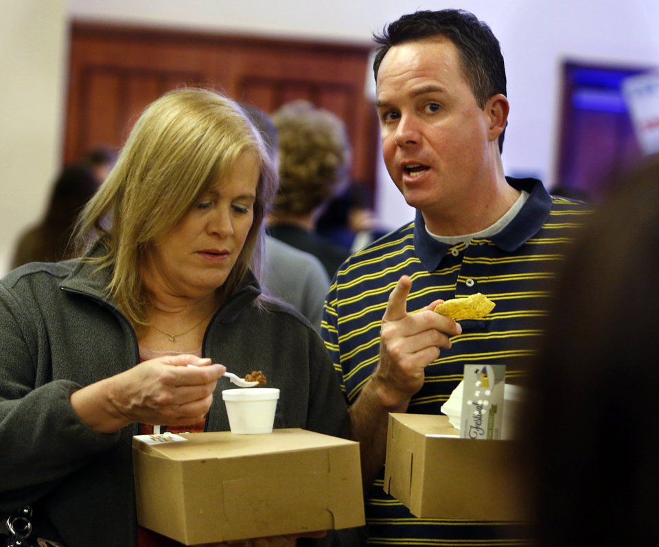 Michele McDonald and Aaron Jones sample chocolate chili and dip at the Firehouse Art Center's annual Chocolate Festival on Saturday, Feb. 2, 2013 in Norman, Okla.  Photo by Steve Sisney, The Oklahoman