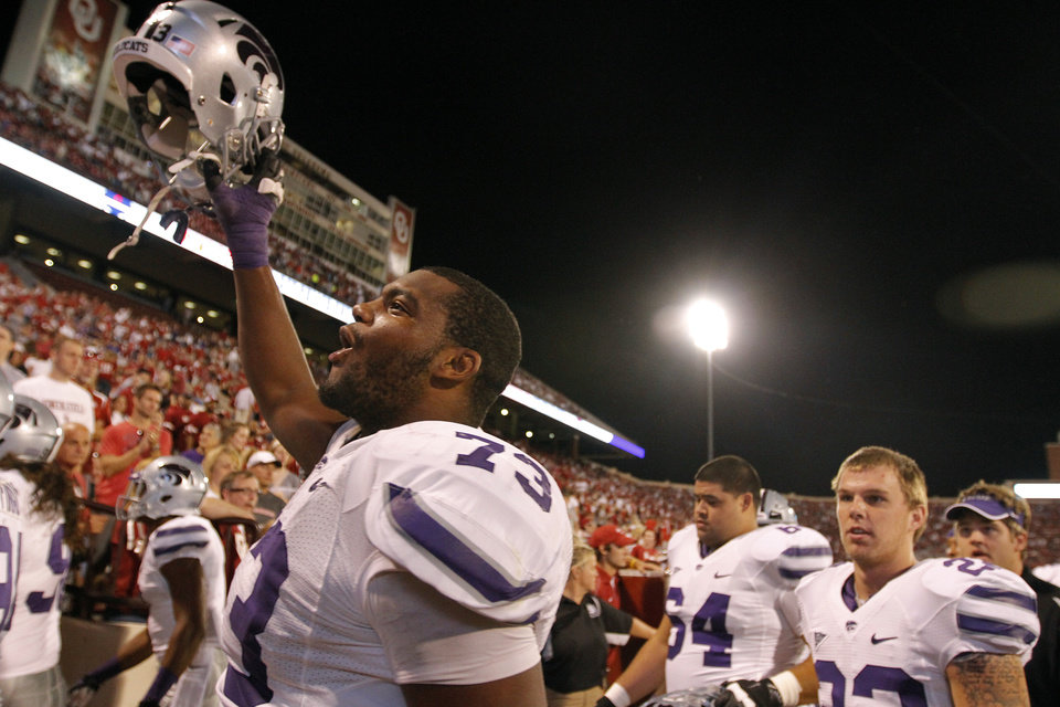 Kansas State's Tavon Rooks (73) celebrates the 24-19 win over Oklahoma during the college football game between the University of Oklahoma Sooners (OU) and the Kansas State University Wildcats (KSU) at the Gaylord Family-Memorial Stadium on Saturday, Sept. 22, 2012, in Norman, Okla. Photo by Chris Landsberger, The Oklahoman