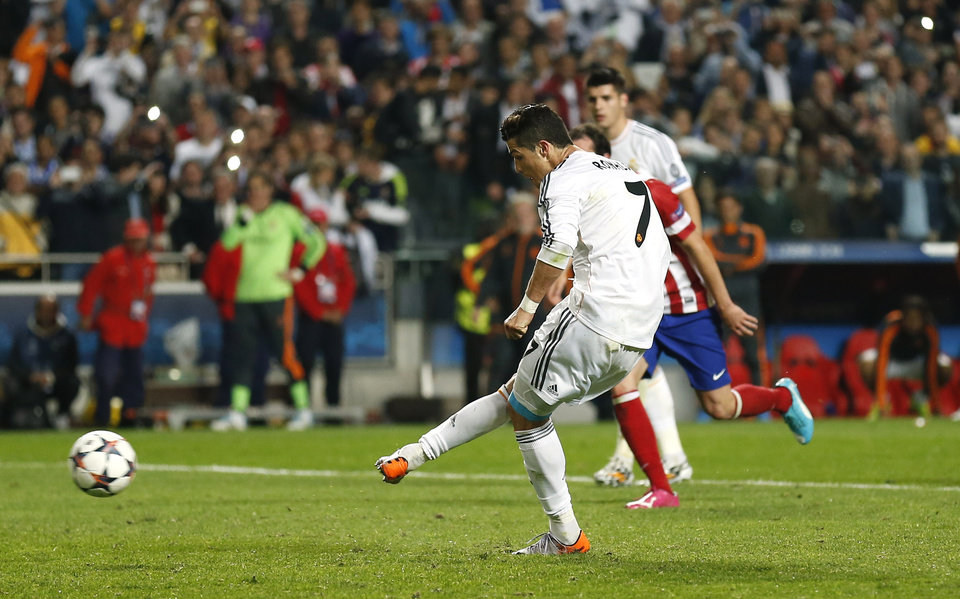 Photo - Real's Cristiano Ronaldo takes a penalty shot, during the Champions League final soccer match between Atletico Madrid and Real Madrid in Lisbon, Portugal, Saturday, May 24, 2014. (AP Photo/Andres Kudacki)