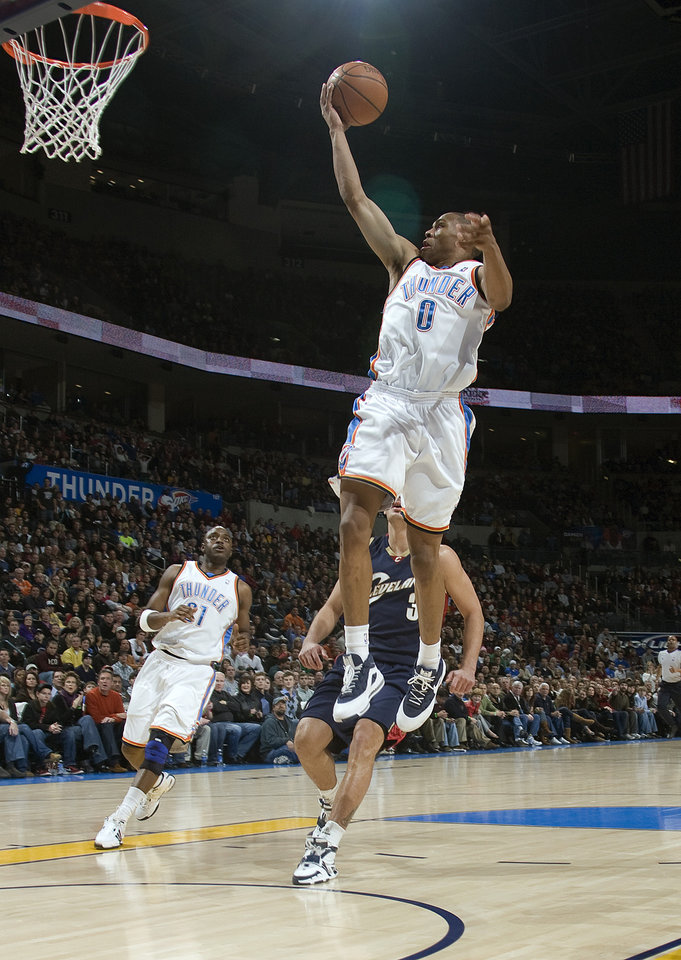 Photo - Oklahoma City's Russell Westbrook (0) shoots a lay up during the NBA game between the Oklahoma City Thunder and Cleveland Cavaliers, Sunday, Dec. 21, 2008, at the Ford Center in Oklahoma City. PHOTO BY SARAH PHIPPS, THE OKLAHOMAN