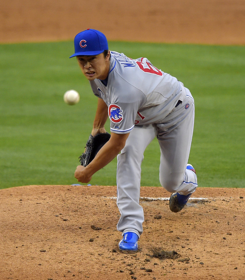 Photo - Chicago Cubs starting pitcher Tsuyoshi Wada, of Japan, throws to the plate during the second inning of a baseball game against the Los Angeles Dodgers, Saturday, Aug. 2, 2014, in Los Angeles. (AP Photo/Mark J. Terrill)