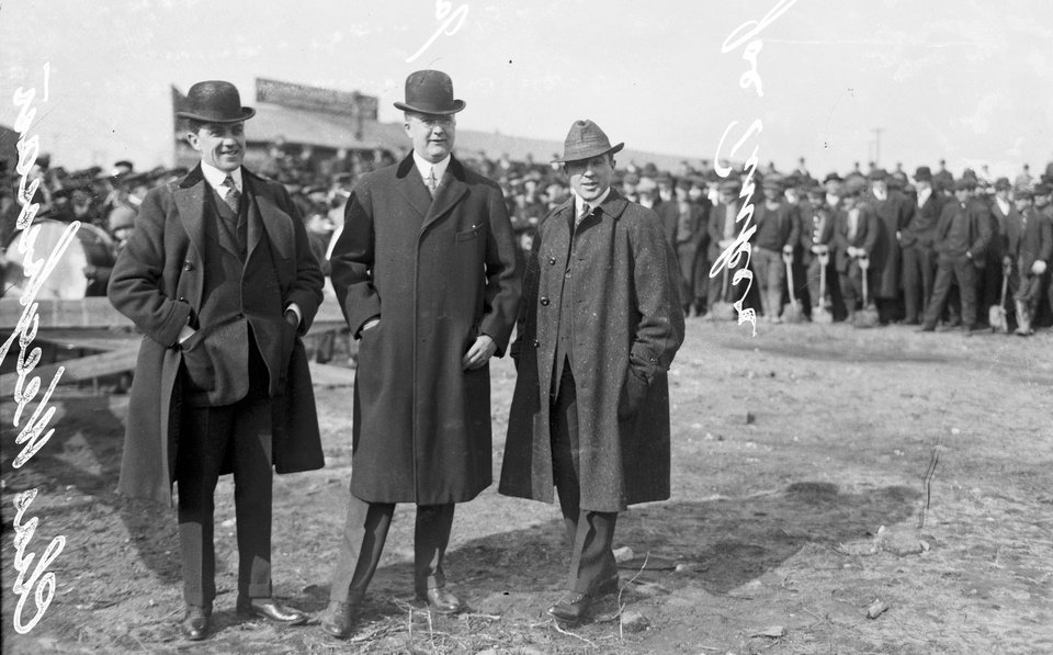 Photo - This 1914 photo provided by the Chicago History Museum shows, from left to right, Charles Weeghman, James Gilmore, and Federal League baseball player Joe Tinker (wearing street clothes), attending the groundbreaking of Weeghman Park in Chicago.  Weeghman Park was renamed Wrigley Field in 1927. The famed ballpark will celebrate it's 100th anniversary on April 23, 2014. (AP Photo/Courtesy of the Chicago History Museum)