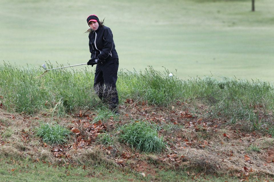 Photo - Tulsa Union's Trudy Allen hits out of the rough during the second day of Girls 6A golf tournament, Thursday, May 2, 2013. The players that tied yesterday play in a playoff due to the rain. Photo By David McDaniel/The Oklahoman