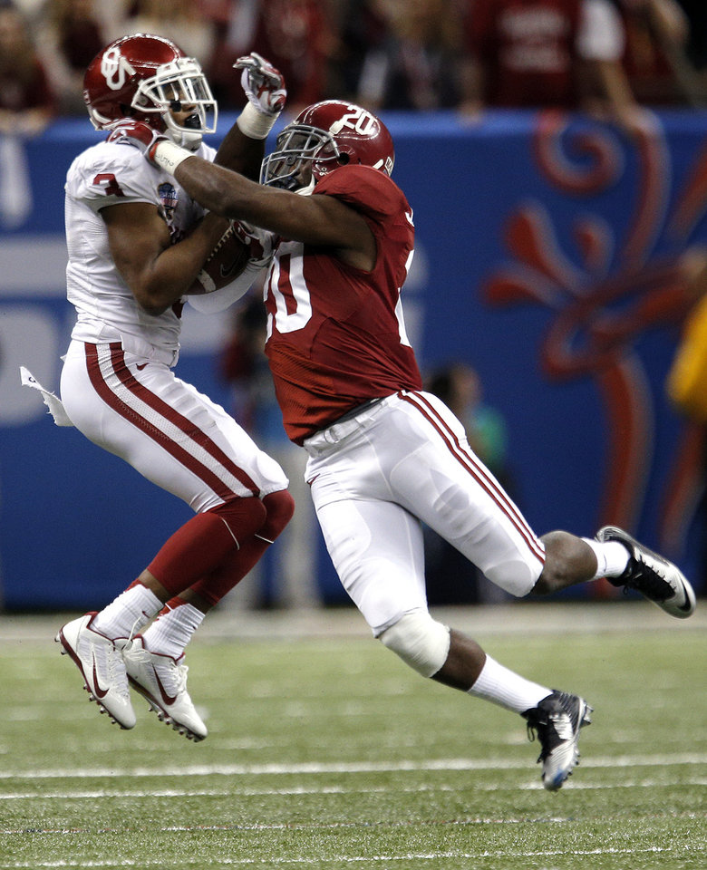 Oklahoma's Sterling Shepard (3) makes a catch Alabama's Jarrick Williams (20) defends during the NCAA football BCS Sugar Bowl game between the University of Oklahoma Sooners (OU) and the University of Alabama Crimson Tide (UA) at the Superdome in New Orleans, La., Friday, Jan. 3, 2014.  .Photo by Sarah Phipps, The Oklahoman